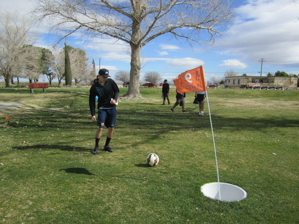 Footgolf player at a green